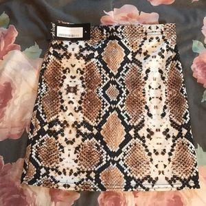 Snakeskin mini skirt from NastyGal